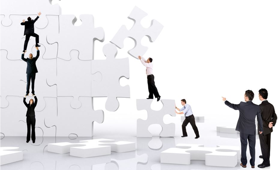 puzzle pieces business man building
