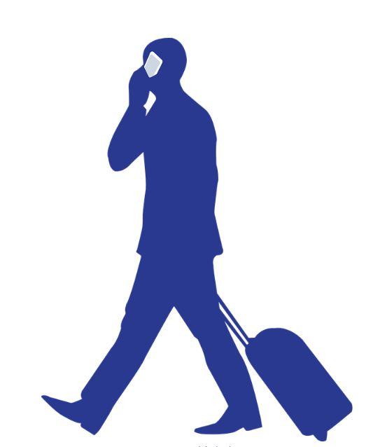 man walking with suitecase blue